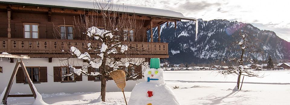 Haus-mit-Schneemann
